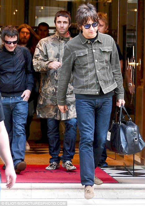 Oasis band members Liam Gallagher, Alan White, Gem Archer and Andy Bellleave their Hotel and go to the Airport